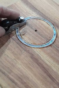 Trimming rosette purfling flush