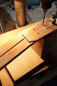 Headstock drilling for tuners