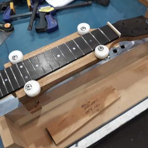 Fretboard glued and ready for clamping