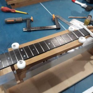 Fretboard aligned and glued to neck