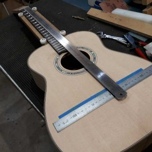46. Final alignment check before fretboard fitted