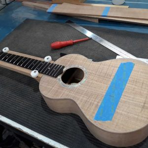 19. Checking fretboard for correct alignment