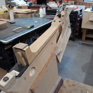 23. Neck clamped in shaping jig
